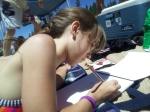 Gabi brought her sketch pad to work on drawings
