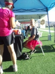 Olivia handing out Gatorade and Vitamin Water and marking bibs as people finished
