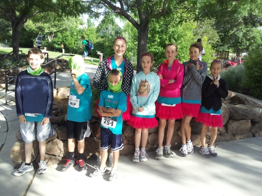 8 of the kids pre race.  Samuel - the youngest - ran the mile, everyone else ran the 5K