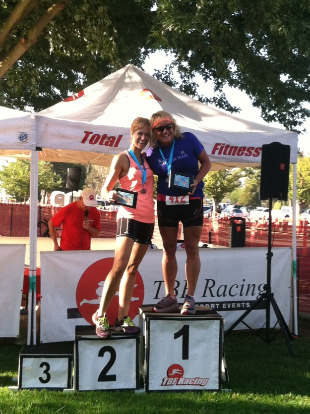 Hugging the 1st place winner on the podium getting 2nd place in the Super Sprint Triathlon