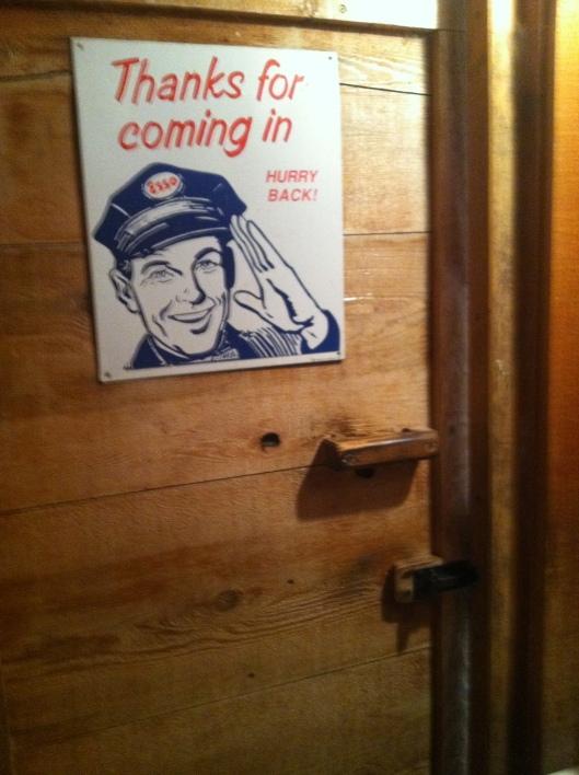 Sign on the bathroom door.