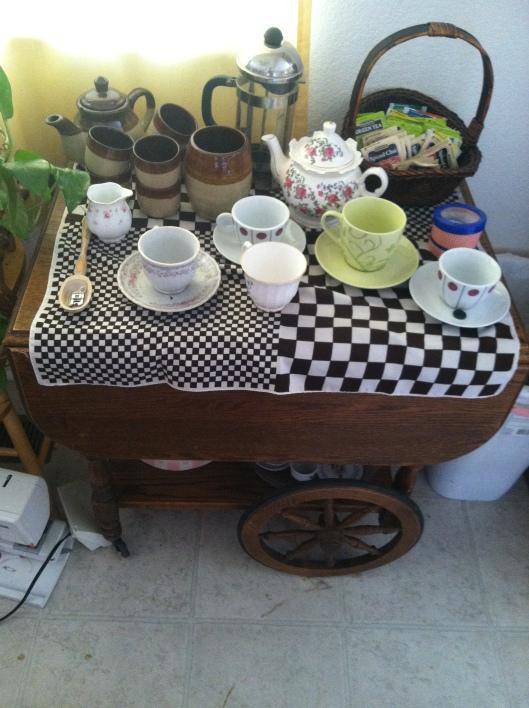 My antique tea cart.  Love my tea!!