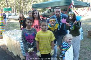 Chris and some of our kids at an aid station at Running with the Bears Marathon in August 2014